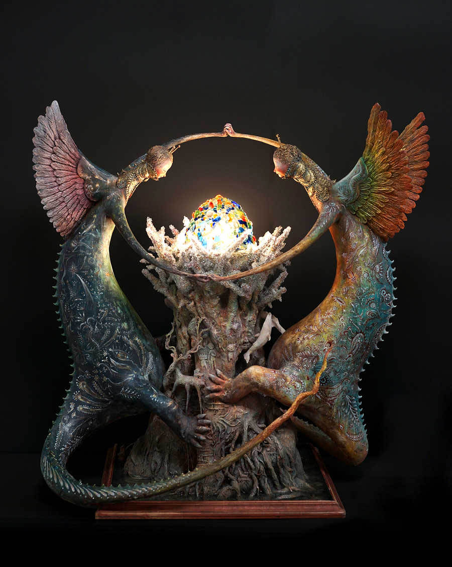 Akishi-ueda-two creatures surrouding an orb